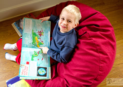 Boy in red denim bean bag chair